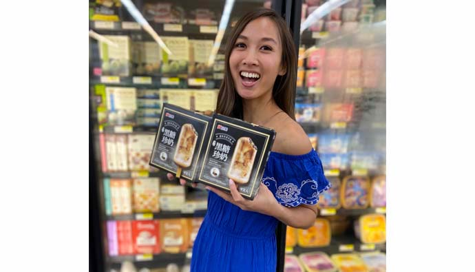 Girl with 2 boxes of brown sugar boba ice cream bar